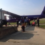 Boarding the purple plane