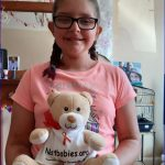 NAIT baby Neve raises awareness with the 1st Aylestone Brownies in Leicester, UK.